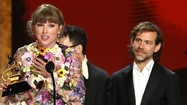Taylor Swift picks up her Grammy for Album of the Year for Folklore