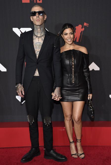 Travis Barker and Kourtney Kardashian at the MTV VMAs red carpet